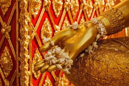 Buddha statue hand with flowers  Wat Phra That Doi Suthep, Chiang Mai, Thailand photo