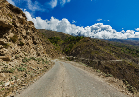 unsurfaced road: Road in Himalayas.  Lahaul valley, Himachal Pradesh, India Stock Photo