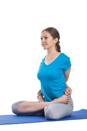 baddha: Yoga - young beautiful woman  yoga instructor doing bound lotus pose (Baddha Padmasana) exercise isolated on white background Stock Photo