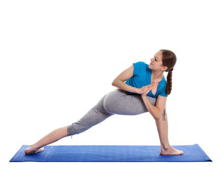 parsvakonasana: Yoga - young beautiful woman  yoga instructor doing Revolved Side Angle Pose (Parivrtta Parsvakonasana) exercise isolated on white background