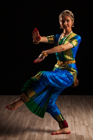 Young beautiful woman dancer exponent of Indian classical dance Bharatanatyam in Shiva pose Stock Photo - 23640732