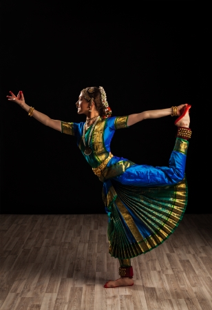Young beautiful woman dancer exponent of Indian classical dance Bharatanatyam