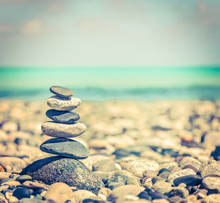 stack rock: balanced stones stack close up on sea beach Stock Photo