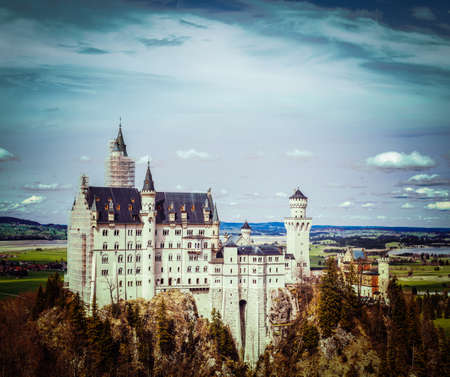 schloss: Vintage retro hipster style travel image of Famous Bavarian landmark - Neuschwanstein Castle (Schloss Neuschwanstein). Bavaria, Germany Editorial