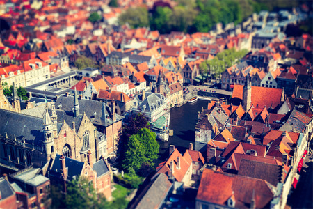 cross processed: Aerial view of Bruges (Brugge) from Belfry, Belgium. Tilf shift effect. Cross processed vintage retro style. Stock Photo