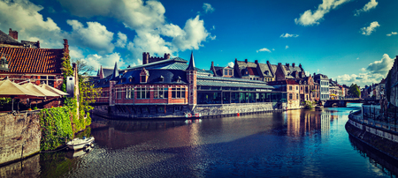Vintage retro hipster style travel image of Ghent canal and medieval building panorama. Ghent, Belgium