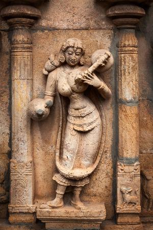 Musician playing veena.Bas reliefes in Hindu temple. Sri Ranganathaswamy Temple. Tiruchirappalli (Trichy), Tamil Nadu, India