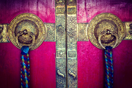 ki: Vintage retro hipster style travel image of door handles on gates of Ki monastry. Spiti Valley, Himachal Pradesh, India