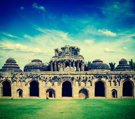 Vintage retro hipster style travel image of ancient ruins of Elephant Stables, Royal Centre. Hampi, Karnataka, India. Stitched panorama photo
