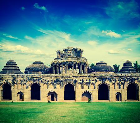 horizontals: Vintage retro hipster style travel image of ancient ruins of Elephant Stables, Royal Centre. Hampi, Karnataka, India. Stitched panorama