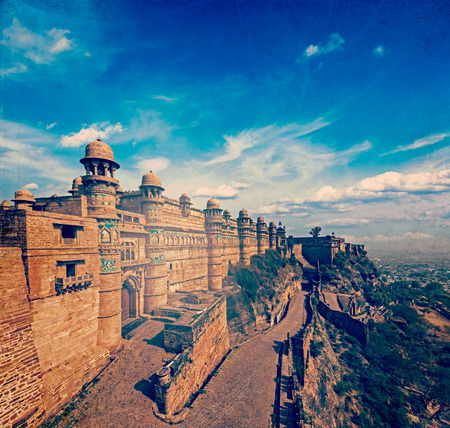 madhya pradesh: Vintage retro hipster style travel image of India tourist attraction - Mughal architecture - Gwalior fort with overlaid grunge texture. Gwalior, Madhya Pradesh, India