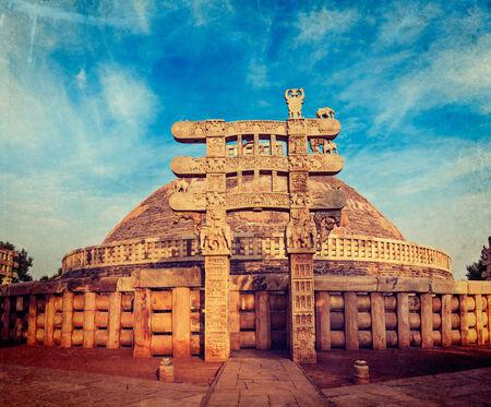 Vintage retro hipster style travel image of Great Stupa - ancient Buddhist monument with overlaid grunge texture. Sanchi, Madhya Pradesh, India