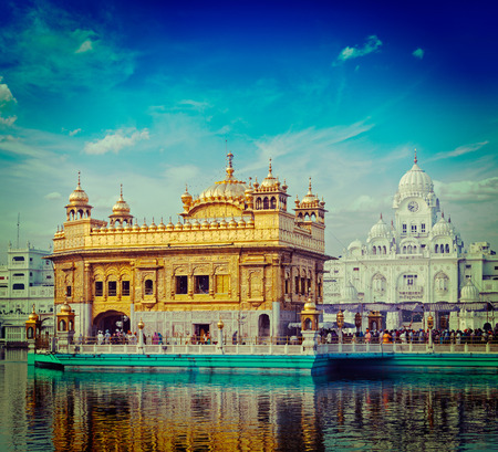 temple tank: Vintage retro hipster style travel image of famous India attraction Sikh gurdwara Golden Temple (Harmandir Sahib). Amritsar, Punjab, India