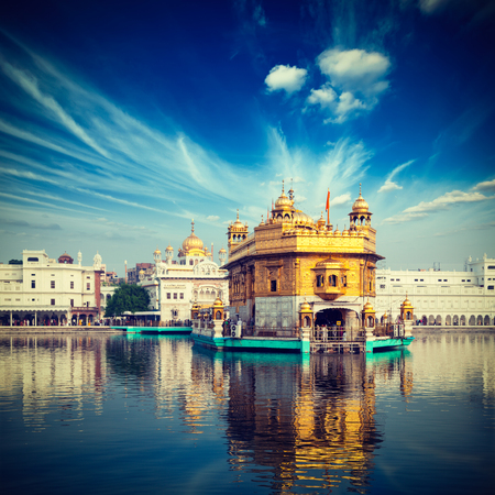 gurdwara: Vintage retro hipster style travel image of famous India attraction Sikh gurdwara Golden Temple (Harmandir Sahib). Amritsar, Punjab, India