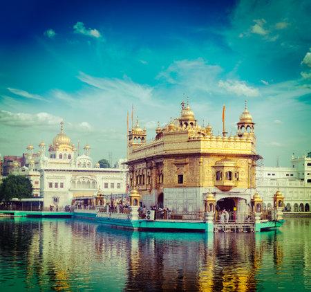 seekhism: Vintage retro hipster style travel image of famous India attraction Sikh gurdwara Golden Temple (Harmandir Sahib). Amritsar, Punjab, India