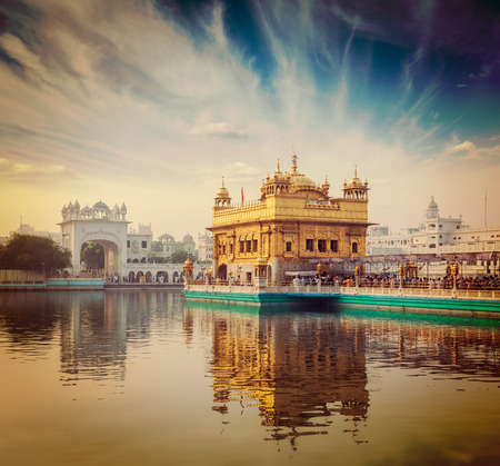 Vintage retro hipster style travel image of famous India attraction Sikh gurdwara Golden Temple (Harmandir Sahib). Amritsar, Punjab, India