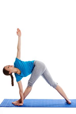 parivrtta: Yoga - young beautiful woman  yoga instructor doing Revolved Triangle asana pose (Parivrtta Trikonasana) exercise isolated on white background