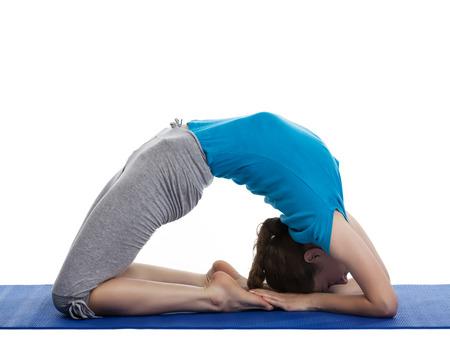 Yoga - young beautiful woman yoga instructor doing Pigeon pose asana(kapotasana) exercise isolated on white background photo