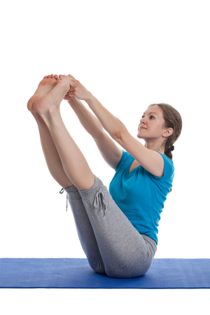 hatha: Yoga - young beautiful woman  yoga instructor doing Both Big Toe hatha Yoga asana pose (Ubhaya padangusthasana) exercise isolated on white background Stock Photo