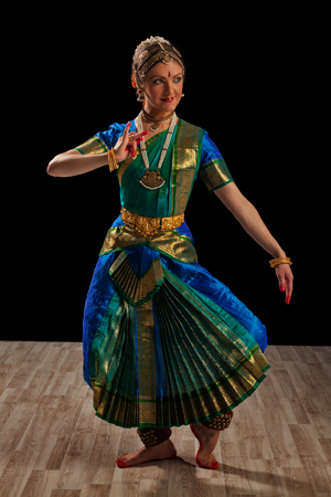 Young beautiful woman dancer exponent of Indian classical dance Bharatanatyam photo