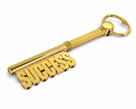 Success wealth prosperity concept - golden key to success made of gold isolated on white background photo
