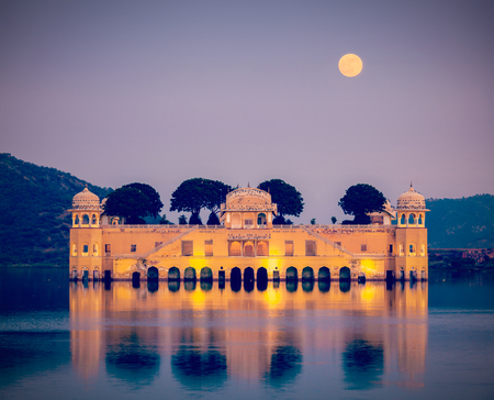 ancient india: Vintage retro hipster style travel image of Rajasthan landmark - Jal Mahal (Water Palace) on Man Sagar Lake in the evening in twilight.  Jaipur, Rajasthan, India