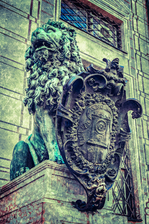 alte: Vintage retro hipster style travel image of Bavarian lion statue at Munich Alte Residenz palace in Odeonplatz with overlaid grunge texture. Munich, Bavaria, Germany