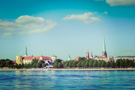 st jamess: Vintage retro hipster style travel image of  View of Riga over Daugava river: Riga Castle, St. Jamess Cathedral, St. Peters Church. Riga, Latvia