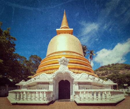 dagoba: Vintage retro hipster style travel image of buddhist dagoba (stupa) close up  with grunge texture overlaidin Golden Temple, Dambulla, Sri Lanka