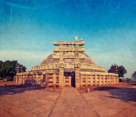 Vintage retro hipster style travel image of Great Stupa - ancient Buddhist monument with overlaid grunge texture. Sanchi, Madhya Pradesh, India