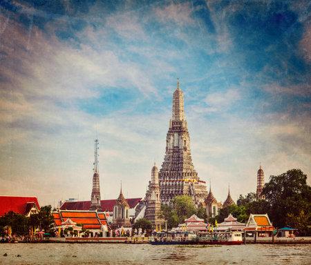 phraya: Vintage retro hipster style travel image of Buddhist temple (wat) Wat Arun on Chao Phraya River with grunge texture overlaid. Bangkok, Thailand Editorial