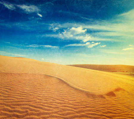 cross processed: Vintage retro hipster style travel image of  white sand dunes on sunrise, Mui Ne, Vietnam with grunge texture overlaid Stock Photo