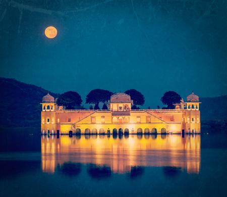 sagar: Vintage retro hipster style travel image of Rajasthan landmark - Jal Mahal (Water Palace) on Man Sagar Lake in the evening in twilight with grunge texture overlaid.  Jaipur, Rajasthan, India Stock Photo
