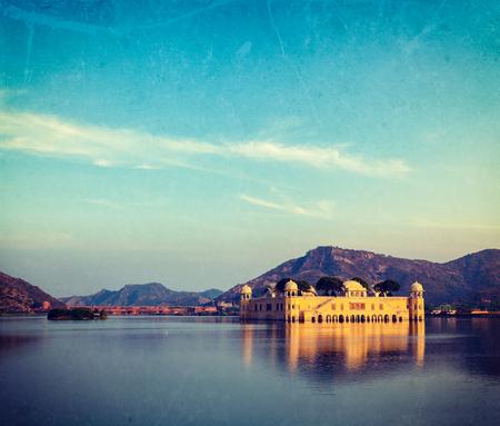 sagar: Vintage retro hipster style travel image of Rajasthan landmark - Jal Mahal (Water Palace) on Man Sagar Lake on sunset with grunge texture overlaid.  Jaipur, Rajasthan, India