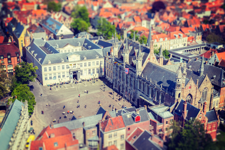 burg: Vintage retro hipster style travel image of aerial view of the Burg square with the City Hall. Bruges (Brugge) , Belgium Stock Photo