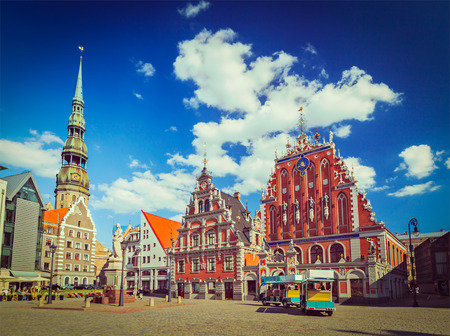 peters: Vintage retro hipster style travel image of  Riga Town Hall Square, House of the Blackheads and St. Peters Church, Riga, Latvia Editorial
