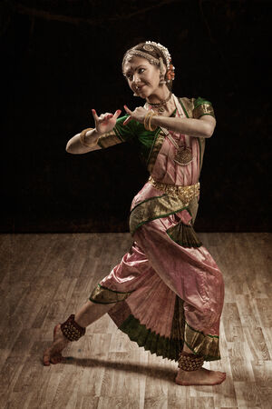 bharatanatyam dance: Vintage retro style image of young beautiful woman dancer exponent of Indian classical dance Bharatanatyam in Krishna pose