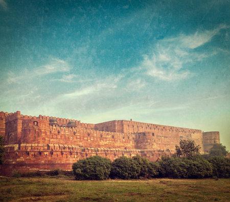 uttar pradesh: Vintage retro hipster style travel image of Agra Fort with grunge texture overlaid. Agra, Uttar Pradesh, India