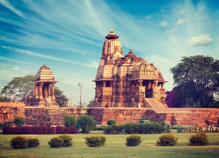 mahadev: Vintage retro hipster style travel image of Khajuraho Devi Jagdamba temple and mahadev mandapa on sunrise. Khajuraho, India Stock Photo