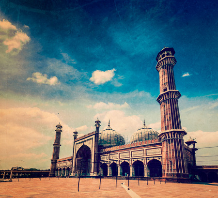 prayer tower: Vintage retro hipster style travel image of Jama Masjid - largest muslim mosque in India with grunge texture overlaid. Delhi, India Stock Photo