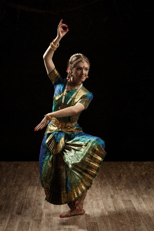 bharatanatyam dance: Vintage retro style image of young beautiful woman dancer exponent of Indian classical dance Bharatanatyam in Shiva pose