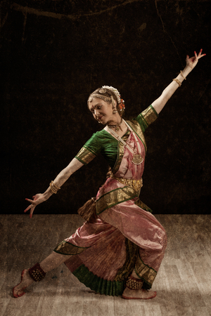 bharatanatyam dance: Vintage retro style image of young beautiful woman dancer exponent of Indian classical dance Bharatanatyam