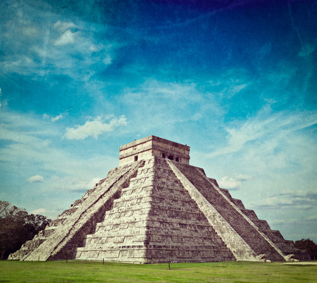 Vintage retro hipster style travel image of travel Mexico background - Anicent Maya mayan pyramid El Castillo (Kukulkan) in Chichen-Itza, Mexico with grunge texture overlaid photo