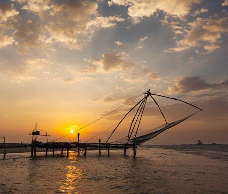 Kochi chinese fishnets on sunset. photo