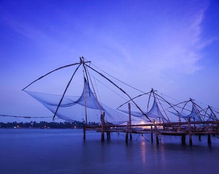 india fisherman: Kochi chinese fishnets on sunset.  Stock Photo