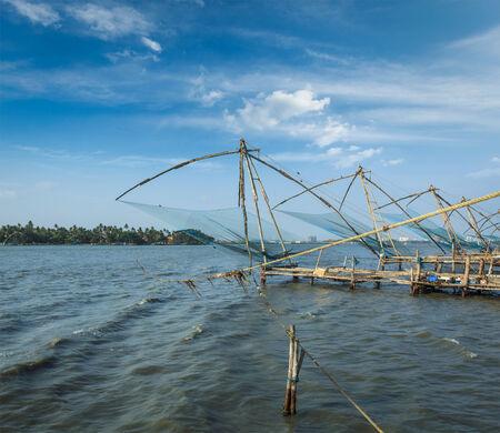 Kochi chinese fishnets on sunset. Fort Kochin, Kochi, Kerala, India photo