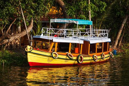 kerala backwaters: Colorful boat on Kerala backwaters. Kerala, India Stock Photo