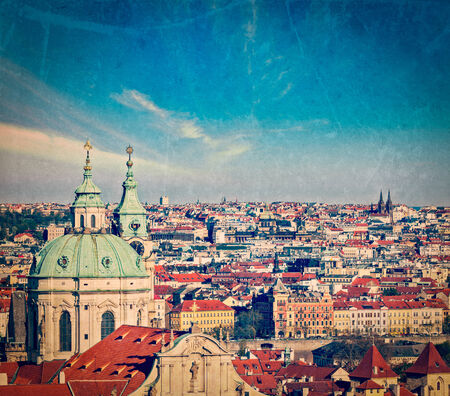 tynsky church: Vintage retro hipster style travel image of aerial view of Prague from Prague Castle. Prague, Czech Republic  with grunge texture overlaid