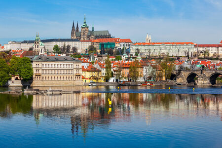 View of Charles bridge over Vltava river and Gradchany (Prague Castle) and St. Vitus Cathedral photo