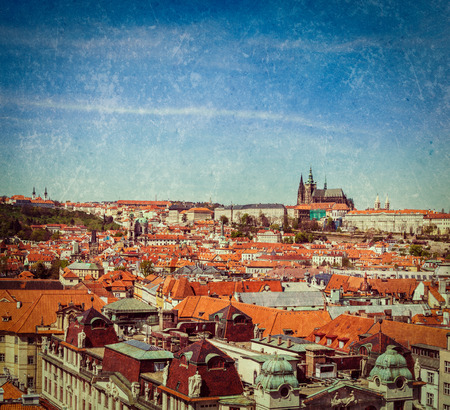 stare mesto: Vintage retro hipster style travel image of Stare Mesto (Old City) and and St. Vitus Cathedral from Town Hall. Prague, Czech Republic with grunge texture overlaid